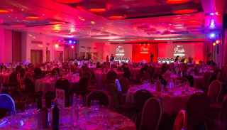 Event venue with red mood lighting for Virgin Holidays