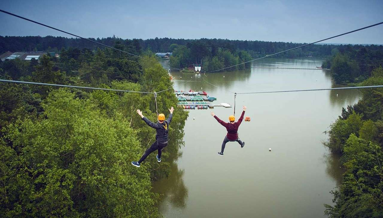 Zip wire over lake at Elveden Forest