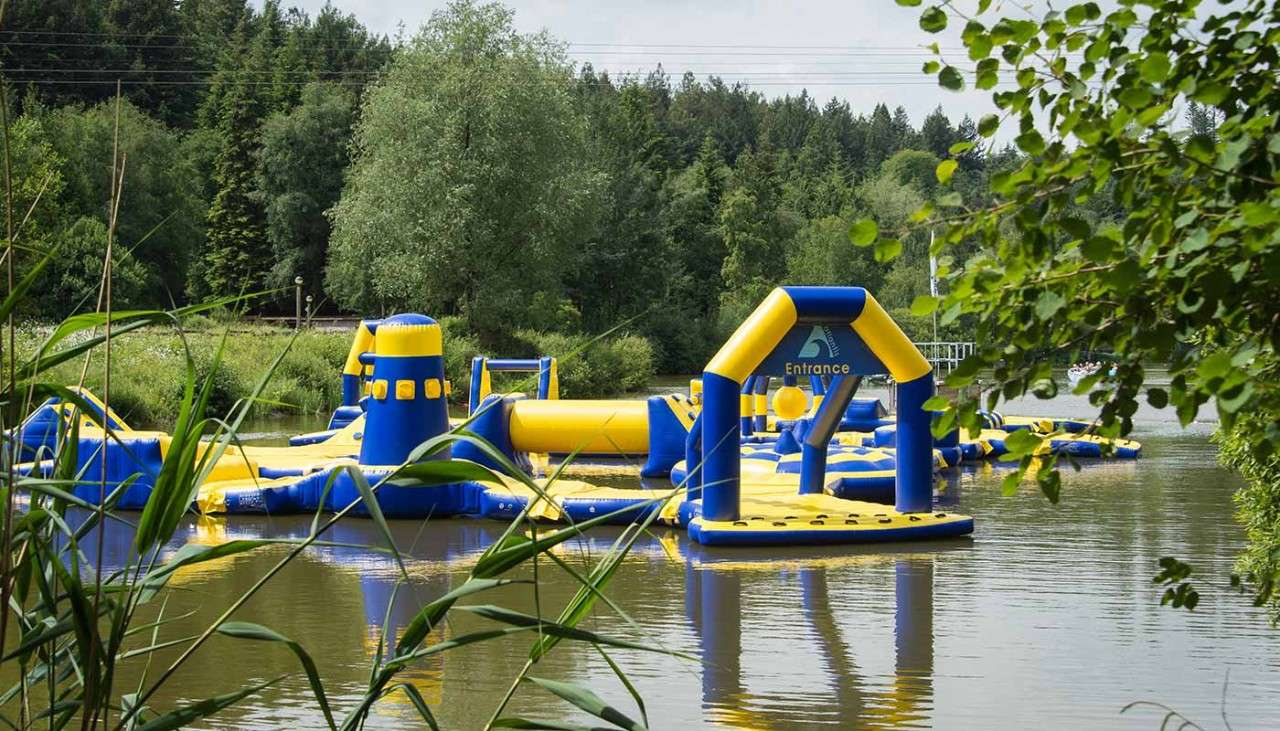 Aqua Parc activity, showing an inflatable obstacle course on the lake