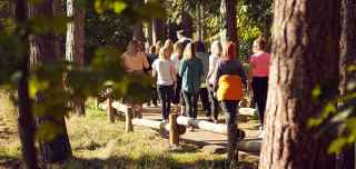 Group walking through Center Parcs