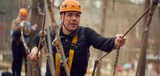 Man aerial adventure activity high in the trees