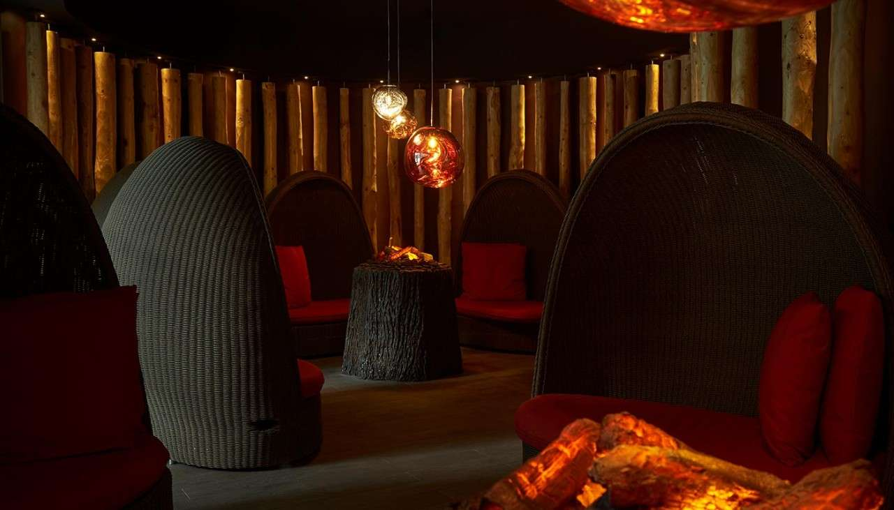 Fireside relax at Aqua Sana Spa with cosy seating around fake fires