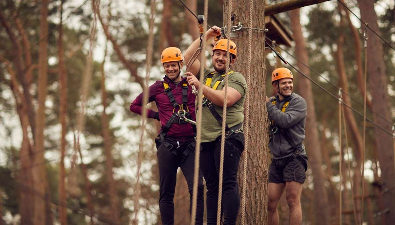 Group ready to descend along a zip line