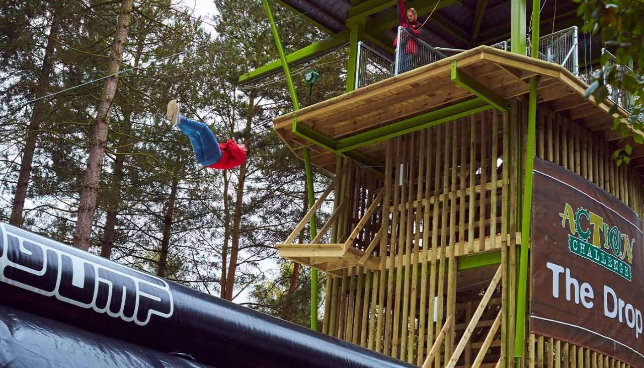Jump from a platform onto a giant airbag on The Drop activity
